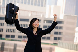 woman with briefcase celebrating