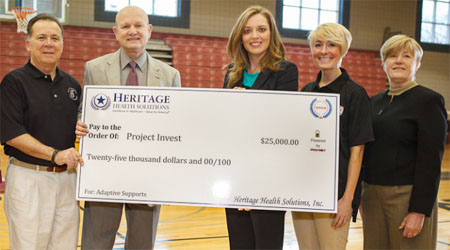 Donation check from Heritage Health Solutions