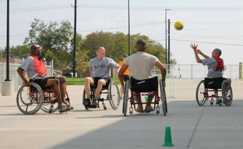photo of men in wheelchairs playing a game