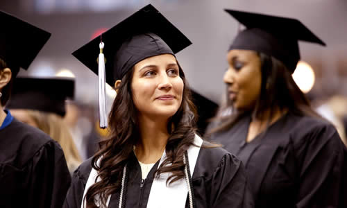 photo of a TWU student in cap and gown during the graduation ceremony