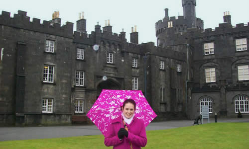 photo of a TWU student in front of an English castle