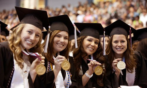 photo of TWU students in cap and gown during the graduation ceremony