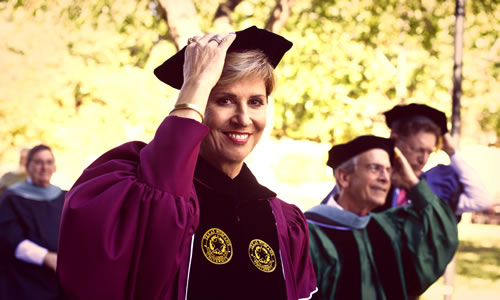 photo of Chancellor Feyten holding her hat in the wind