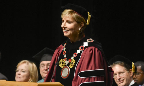 photo of Chancellor Feyten giving her inaugural address