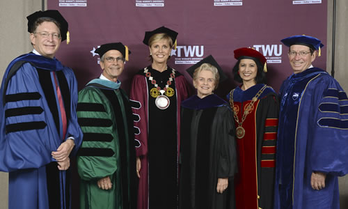 photo of Chancellor Feyten with the presidents and chancellor from other universities who attended her inauguration