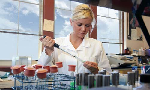 photo of a TWU student in a lab