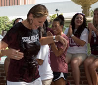 Photo of TWU Chancellor Carine Feyten after she's just been dowsed with ice water