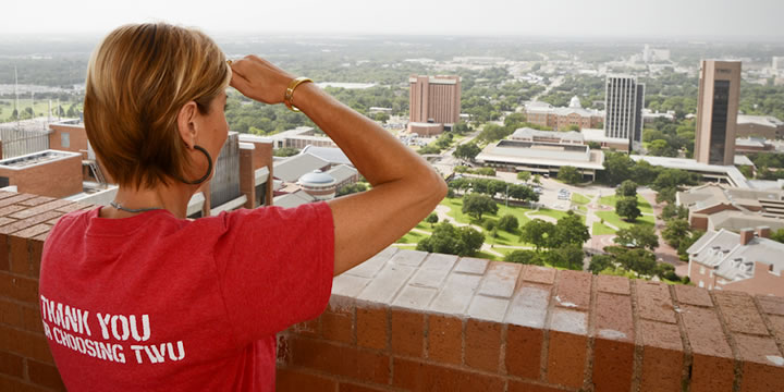 Photo of Dr. Feyten overlooking the TWU Denton campus from the top of Guinn Hall
