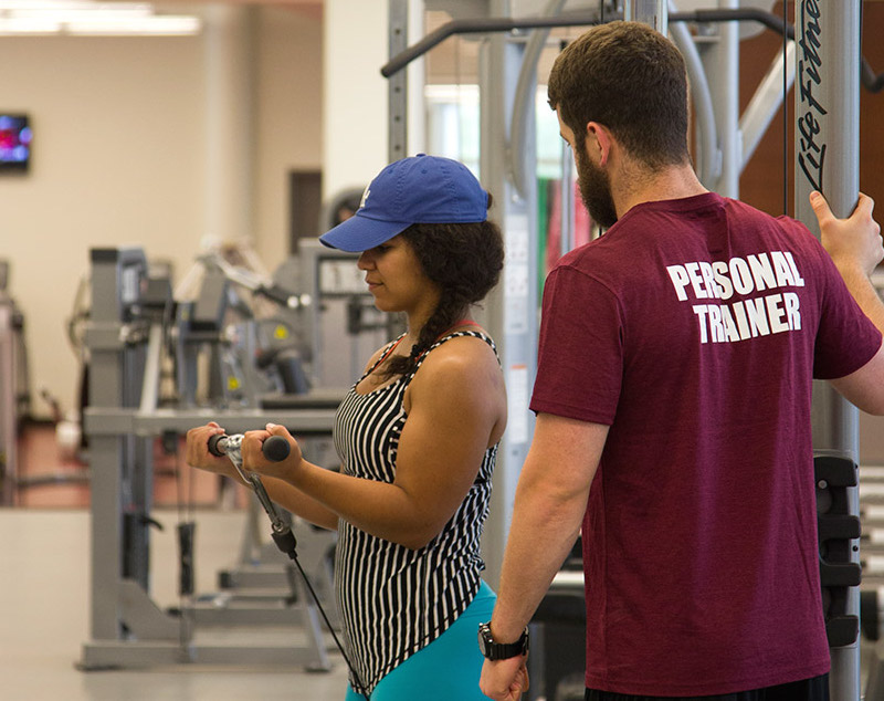 personal trainer with students