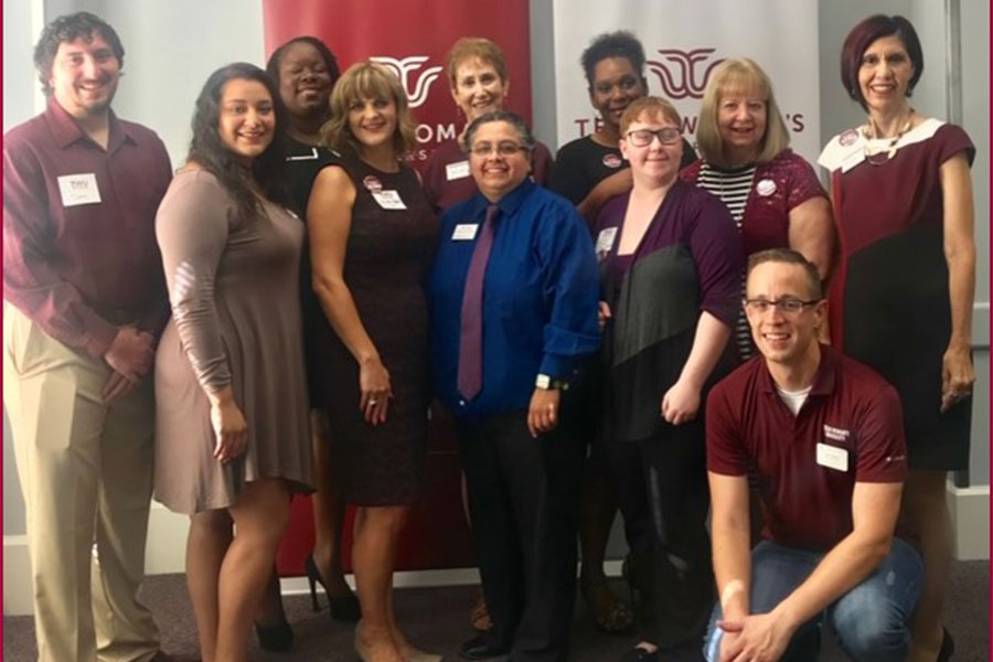 TWU Denton alumni chapter smiles for a group photo.