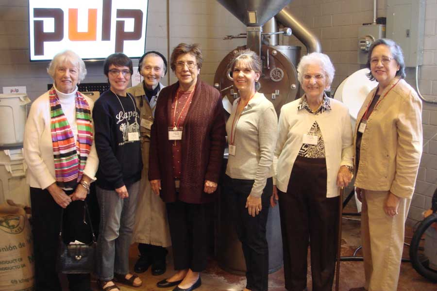 A group of TWU alumni visit a business titled