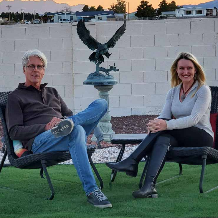 David and Jody Popple sitting by a sculpture