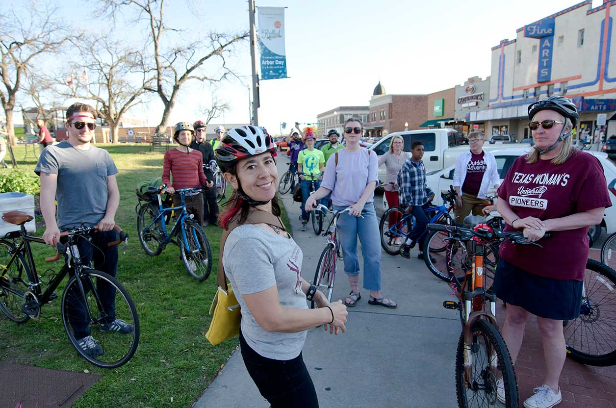 Students with their bikes at the Denton downtown square during the ARTSWALK 2016 bike parade