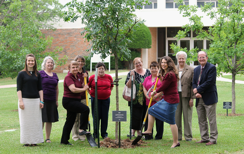 Asset members plant a tree as a celebration of 30 years at TWU.
