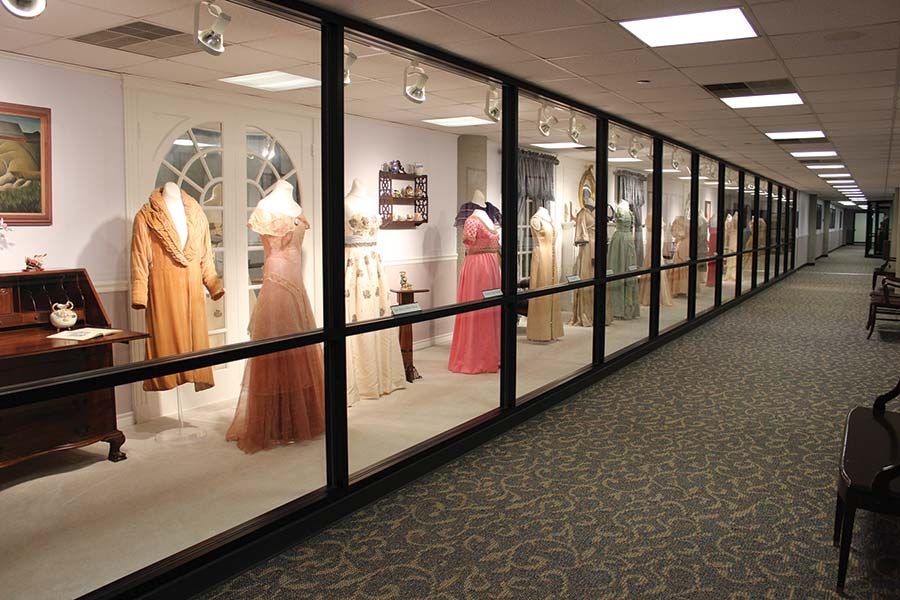 Some of the gowns in the Texas first ladies gown collection, displayed behind glass.