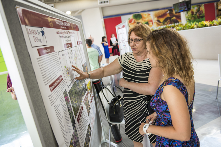 Associate professor Camelia Maier, Ph.D., presents her research to the public during TWU's Pioneer Research at the Mall event.