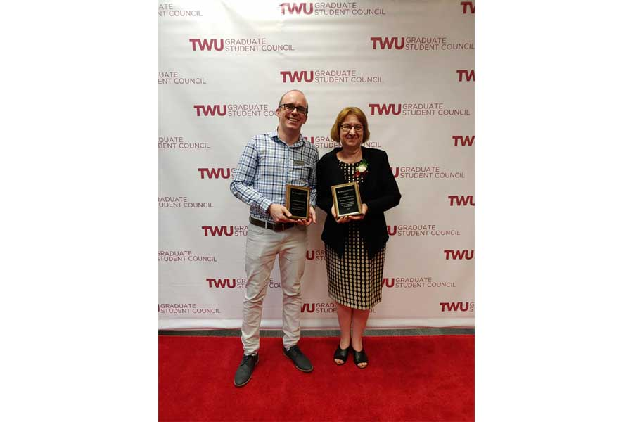 Dr. Lionel Faure, Distinguished Staff Member and Dr. Camelia Maier, Distinguished Graduate Faculty Member, honored at the Pioneering Spirit Awards banquet, celebrating graduate students and those who support them.
