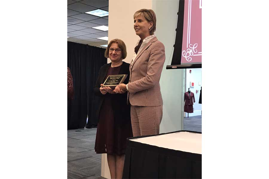 2018-2019 Humphries Award for dedication to TWU, was presented to Dr. Camelia Maier by Dr. Feyton