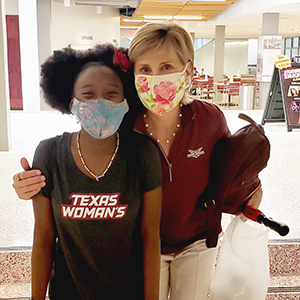 Chancellor Carine M. Feyten with student Hana Taylor Schlitz