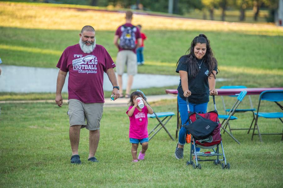 TWU families enjoy a meal together during Family Weekend