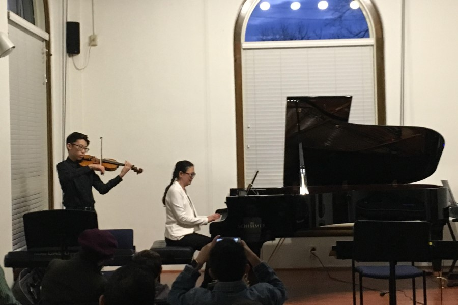 TWU adult beginner piano student Qian Hu accompanied by her son, Ocean Xie, on violin.