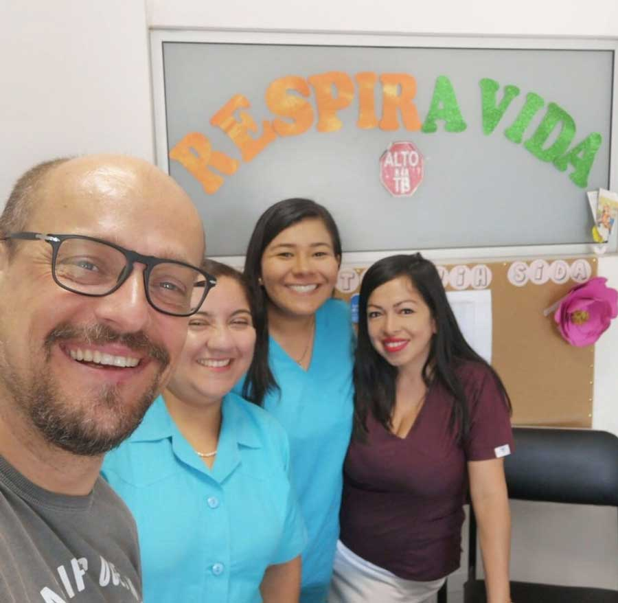 Juan Leyva smiles and poses with research colleagues in Peru.