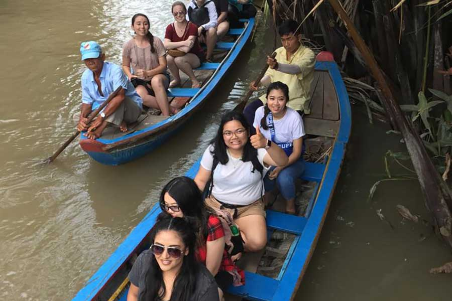 TWU students floating down the Tien Giang river, part of the Mekong river tributaries.