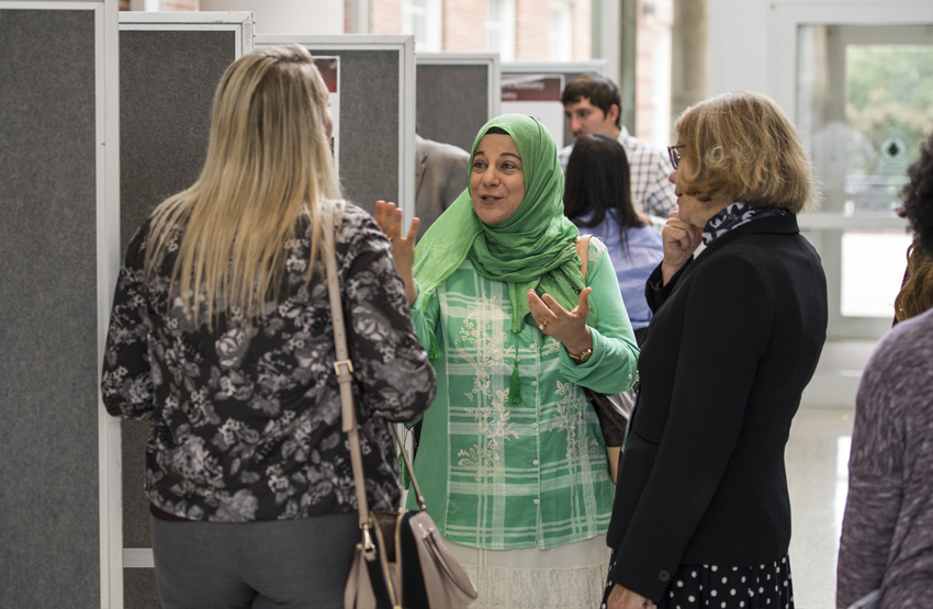 Associate professor Manal Rawashdeh-Omary, PhD, discusses research with guests at TWU's annual Celebration of Science event.