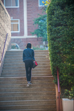 A student walking up stairs on TWU's Denton Campus.