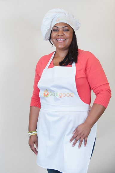 A portrait of Cynthia Nevels in a chef hat and apron.