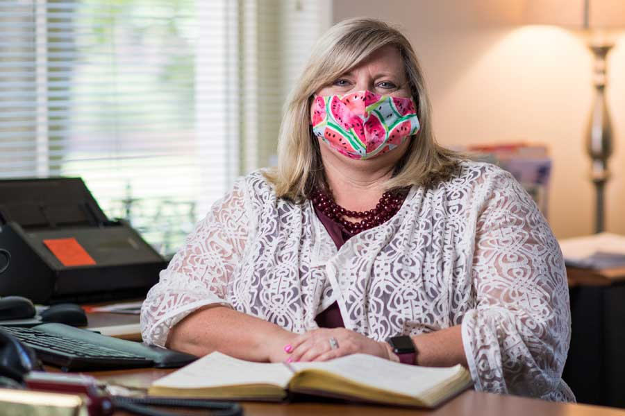 Lisa Huffman, masked at her desk, encourages public to have grace for teachers