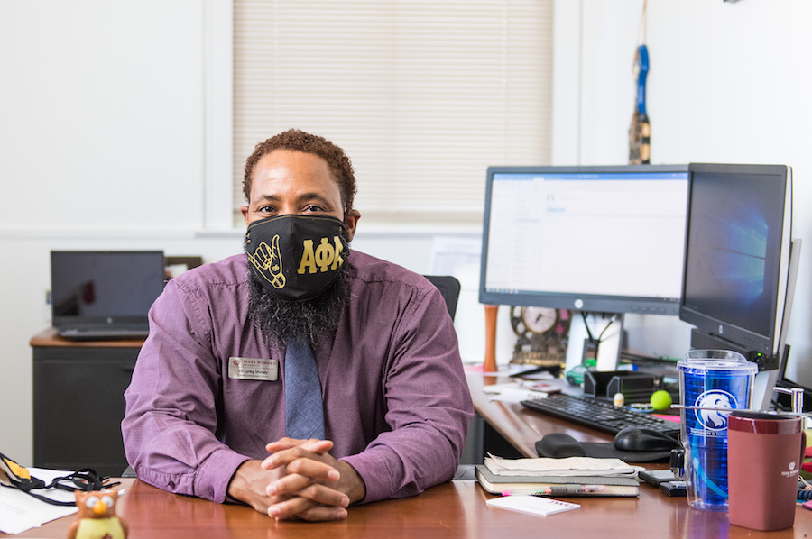 Dr Greg Shirley wears a mask at work at TWU