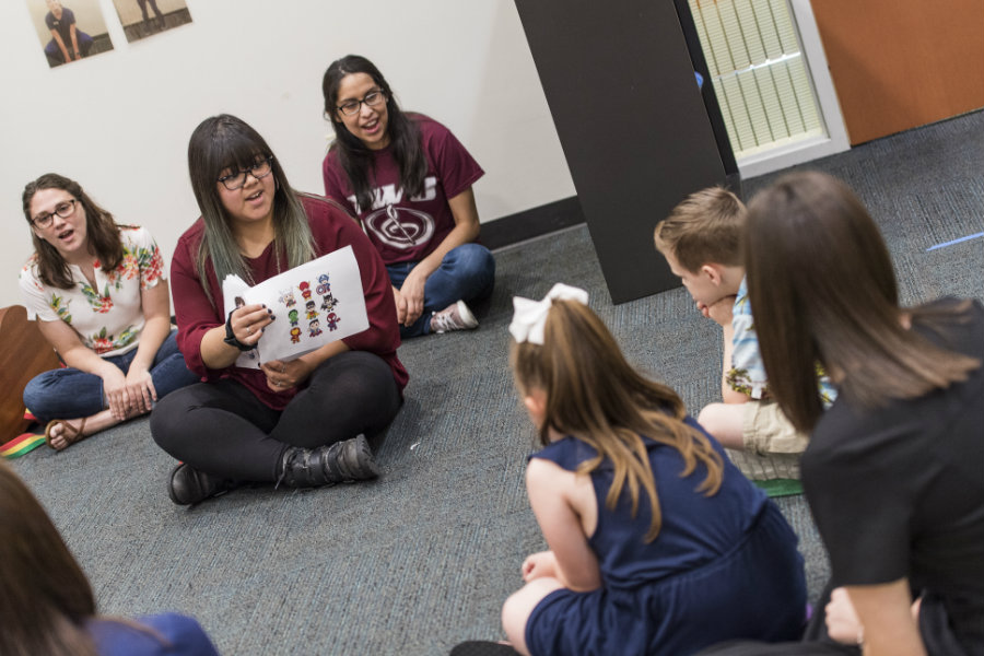 A TWU student teaches to young kids in a speech-language pathology summer camp.