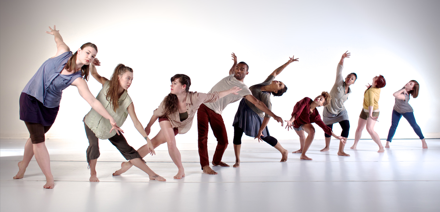 Dancers bending different directions on line.
