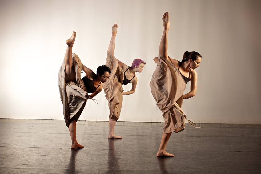 3 students performing a modern dance