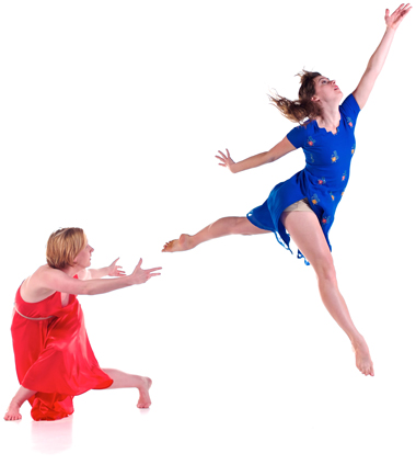Photo of two female dancers in red and blue dresses