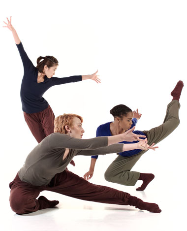 3 students performing modern dance