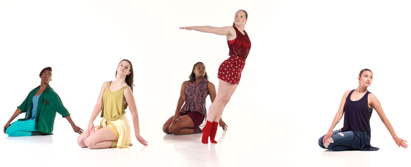 5 female dancers pose in different colored dresses
