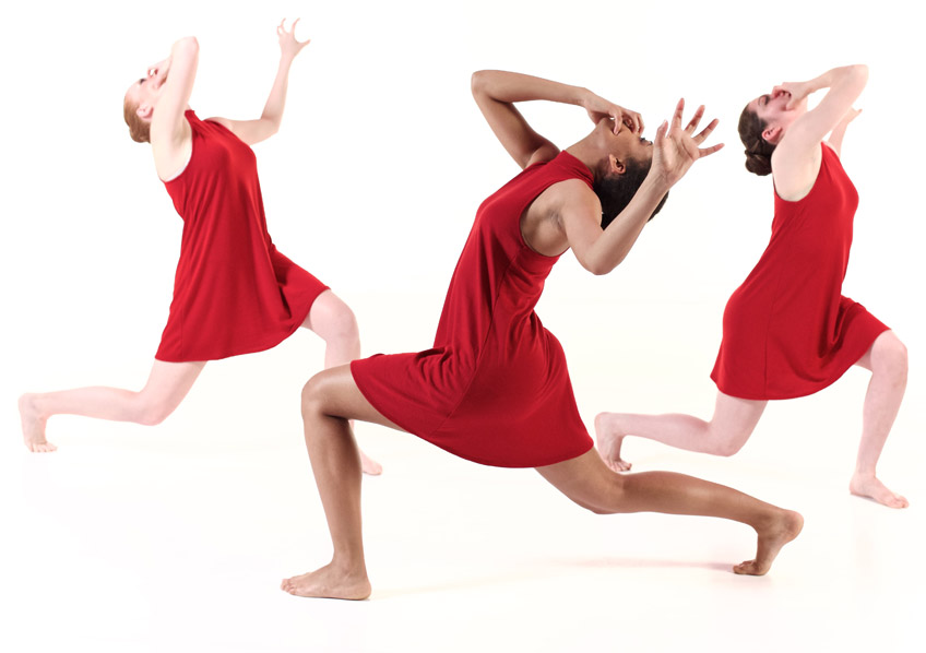 3 students in red dresses performing a modern dance