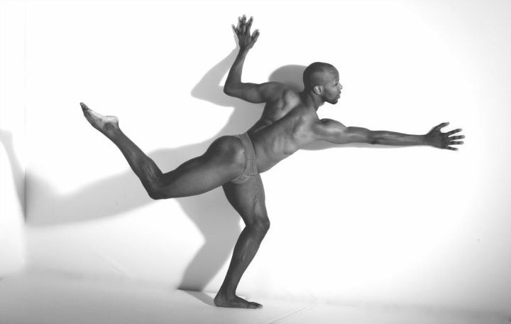 Trent D. Williams performs a dance in black and white