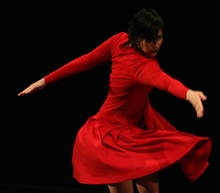 Andee Scott dancing in a red dress
