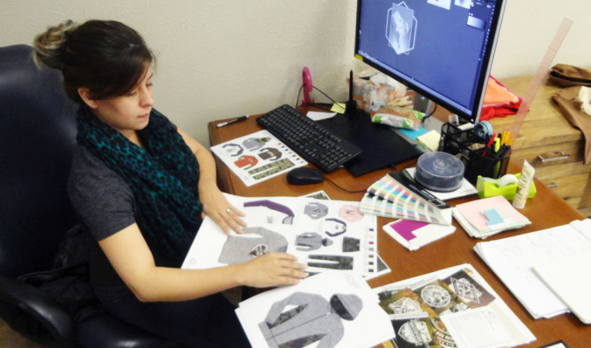 Fashion alumna Stephanie Perez working on designs for Wohali Outdoors.