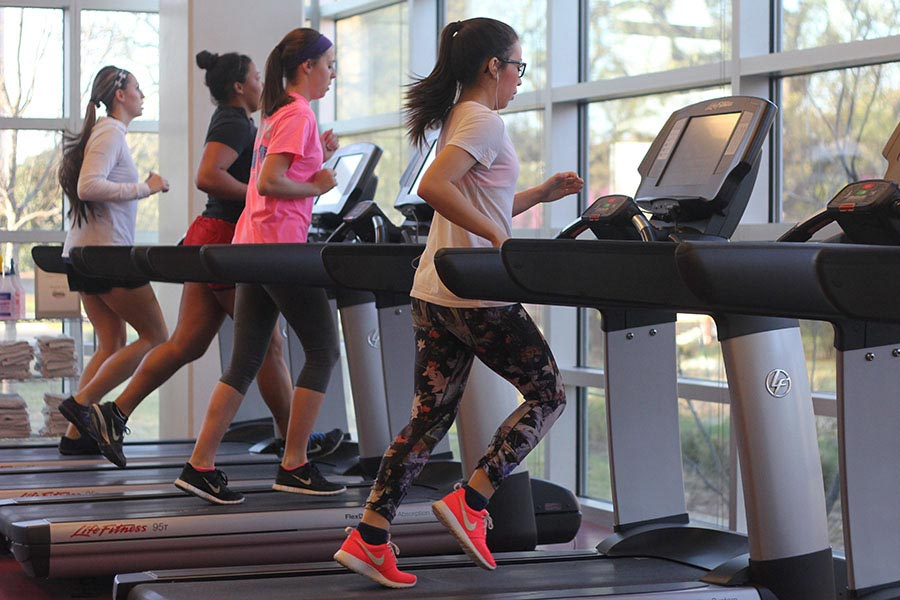 Students running on treadmills at the Denton Fit and Rec