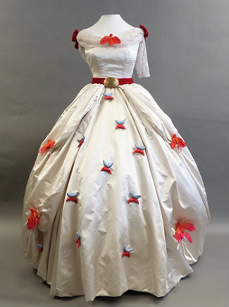 Lubbock's white satin dress with scattered red flowers on the skirt and a red velvet belt.