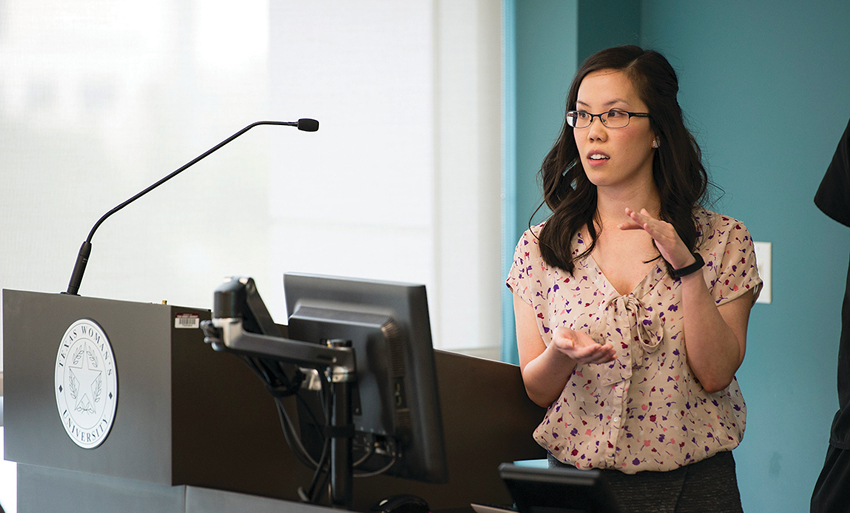 Photo of a student lecturing at a podium