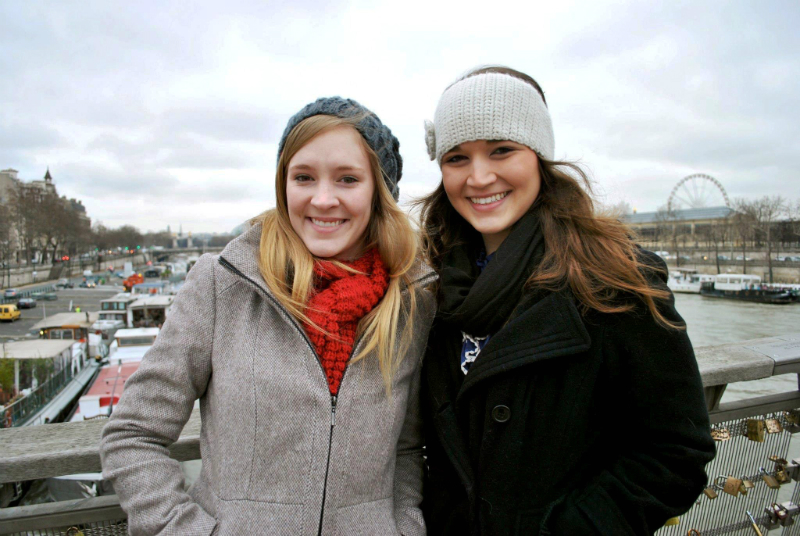 two girls in winter jackets and hats