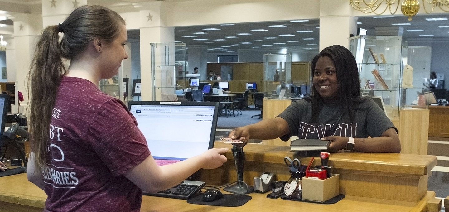 Student receives her new TWU ID card