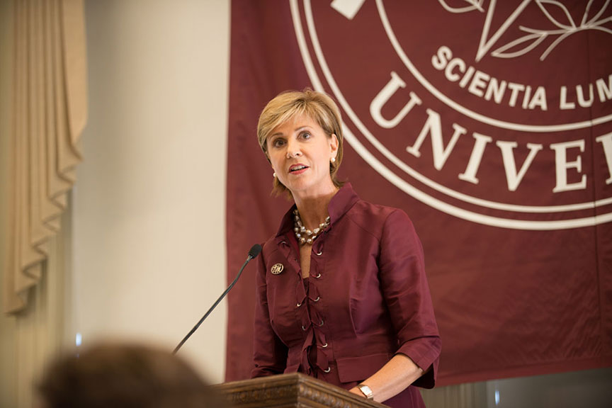 Chancellor Feyten speaks at a podium