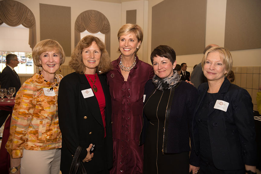 Chancellor Feyten poses with four other women
