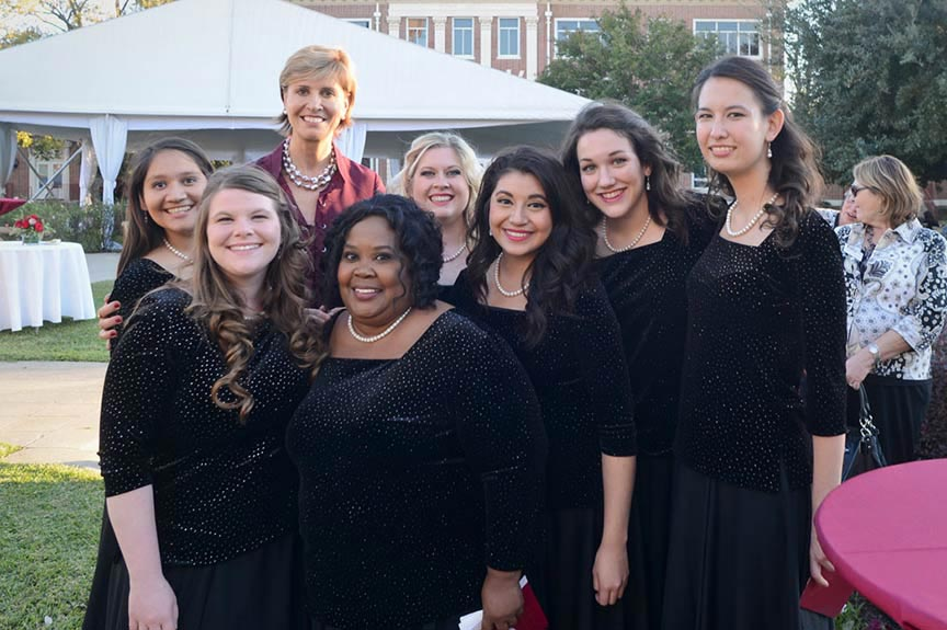 Chancellor Feyten stands with a group of TWU vocal performers